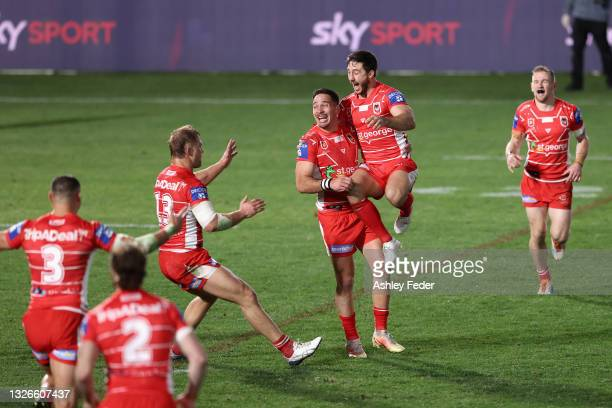 Dragons players celebrate the win from a Golden Point from Corey Norman during the round 16 NRL match between New Zealand Warriors and the St George...