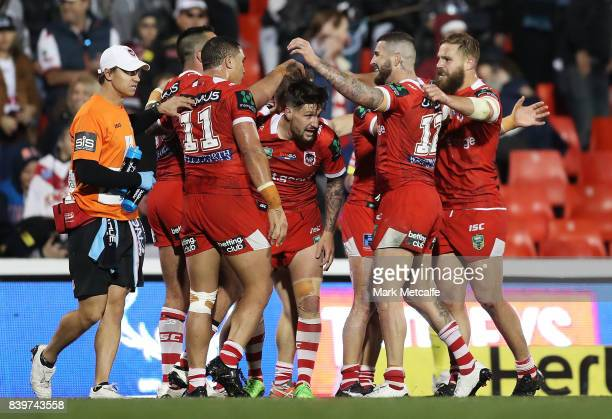 Dragons players celebrate victory in the round 25 NRL match between the Penrith Panthers and the St George Illawarra Dragons at Pepper Stadium on...