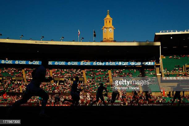 Dragons players run a play during the round 24 NRL match between the St George Illawarra Dragons and the Wests Tigers at Sydney Cricket Ground on...