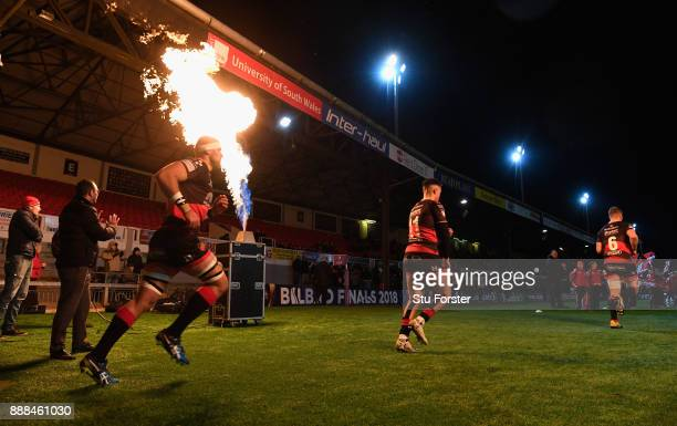 Dragons players run out beside a flame before the European Rugby Challenge Cup match between Dragons and Enisei EM at Rodney Parade on December 8...