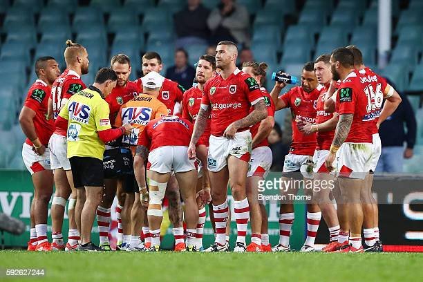 Dragons players show their dejection during the round 24 NRL match between the Sydney Roosters and the St George Illawarra Dragons at Allianz Stadium...