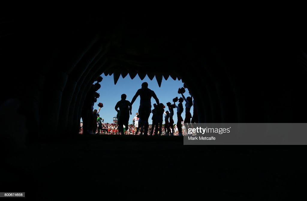 Dragons players walk onto the field for the round 16 NRL match between the St George Illawarra Dragons and the Newcastle Knights at UOW Jubilee Oval on June 25, 2017 in Sydney, Australia.