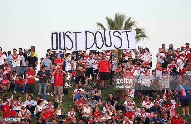 Dragons supporters hold up a banner reading 'Oust Doust' in reference to St George Illawarra Dragons' CEO Peter Doust during the round one NRL match...