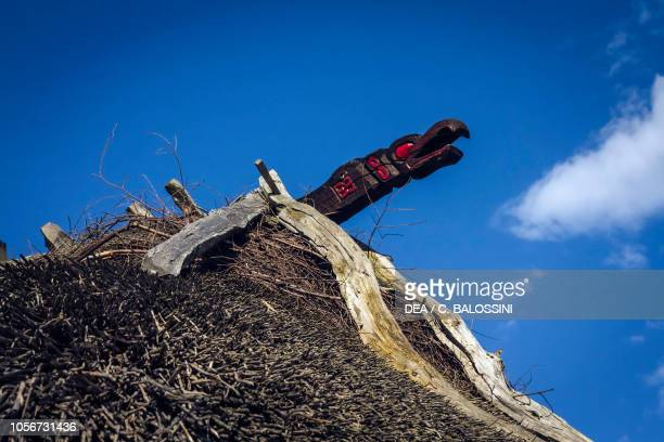 Dragon-shaped sculpture on the ridge of a Viking hut, Festival of Slavs and Vikings, Centre of Slavs and Vikings, Jomsborg-Vineta, Wolin island,...