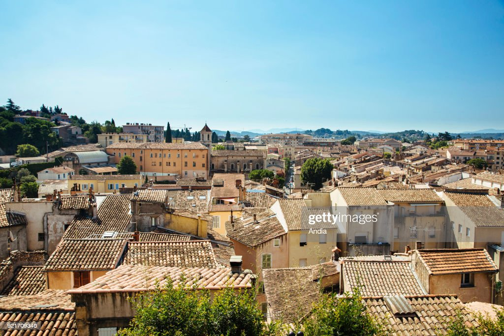 Draguignan (south-eastern France) tiled roofs, rooftop view of the city. In the background, the former convent and chapel 'couvent des Minimes'.