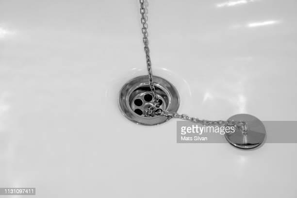 Drain and Drain Hole in Bathtub with Chain