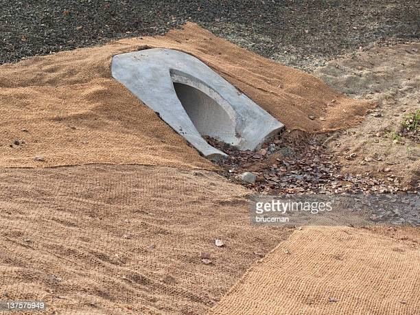 drainage culvert - eroded stock pictures, royalty-free photos & images
