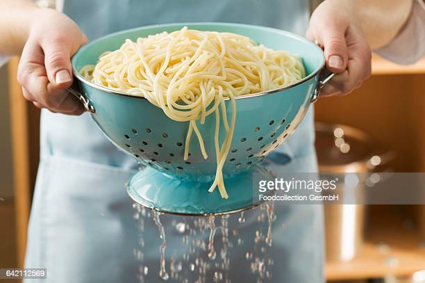 draining cooked spaghetti - boiled stock pictures, royalty-free photos & images