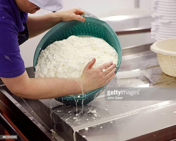 draining freshly made organic cheese