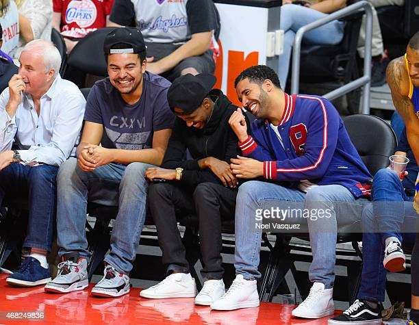 Drake and Alex da Kid attend a basketball game between the Golden State Warriors and the Los Angeles Clippers at Staples Center on March 31 2015 in...