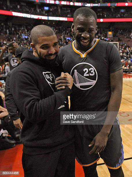 Drake and Draymond Green of the Golden State Warriors after the game against the Toronto Raptors on December 5 2015 at Air Canada Centre in Toronto...