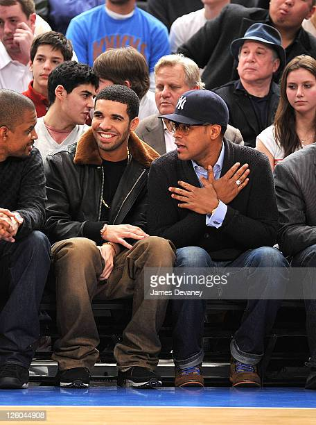 Drake and Maxwell attend the Miami Heat vs New York Knicks game at Madison Square Garden on December 17 2010 in New York City