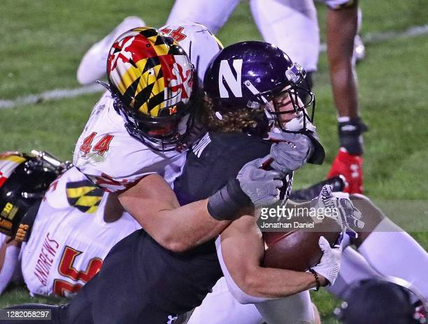 Drake Anderson of the Northwestern Wildcats is tackled by Chance Campbell of the Maryland Terrapins at Ryan Field on October 24, 2020 in Evanston,...