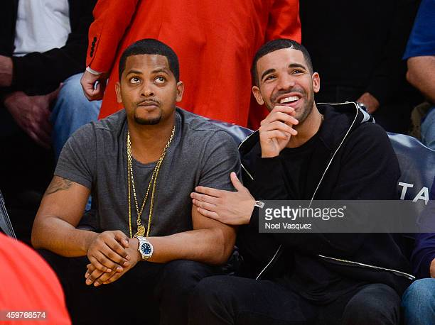 Drake attends a basketball game between the Toronto Raptors and the Los Angeles Lakers at Staples Center on November 30, 2014 in Los Angeles,...
