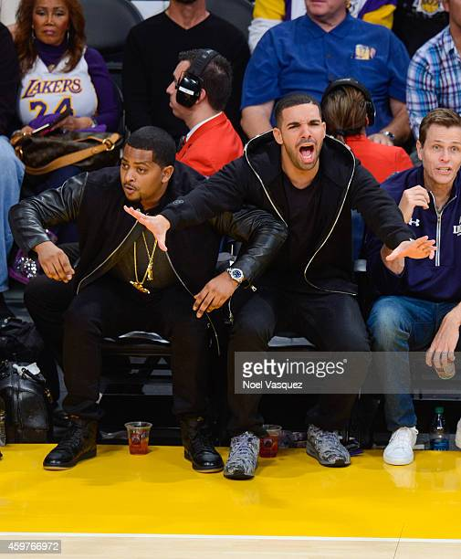 Drake attends a basketball game between the Toronto Raptors and the Los Angeles Lakers at Staples Center on November 30 2014 in Los Angeles California