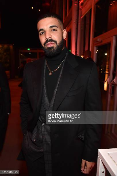 Drake attends the 2018 Vanity Fair Oscar Party hosted by Radhika Jones at Wallis Annenberg Center for the Performing Arts on March 4 2018 in Beverly...