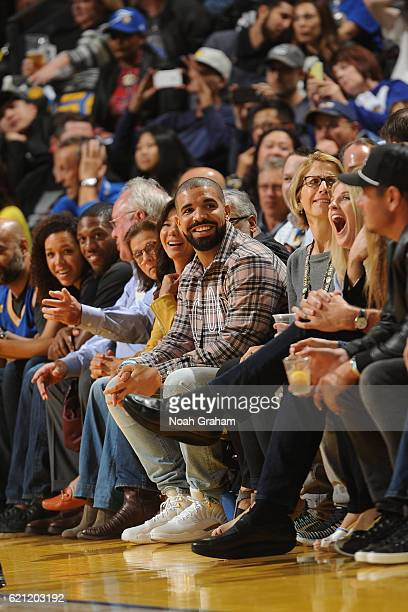 Drake attends the game between the Golden State Warriors and Oklahoma City Thunder on November 3 2016 at ORACLE Arena in Oakland California NOTE TO...