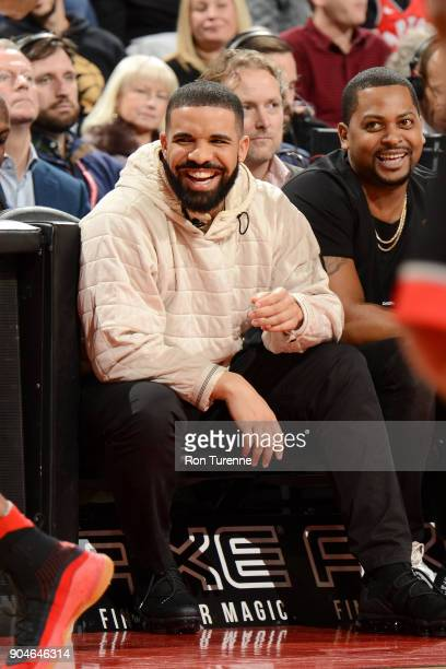 Drake attends the game between the Golden State Warriors and the Toronto Raptors on January 13 2018 at the Air Canada Centre in Toronto Ontario...