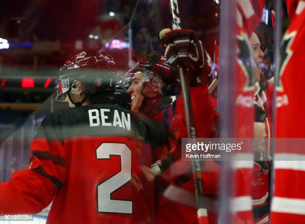 Drake Batherson celebrates his goal against Czech Republic with Jake Bean of Canada during the IIHF World Junior Championship at KeyBank Center on...