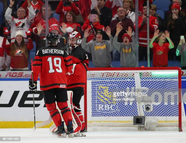 Drake Batherson congratulates Carter Hart of Canada after beating the Czech Republic during the IIHF World Junior Championship at KeyBank Center on...