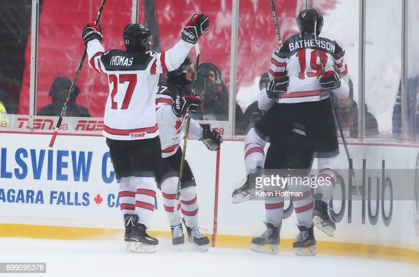 Drake Batherson of Canada celebrates a goal by Cale Makar in the first period against the United States during the IIHF World Junior Championship at...