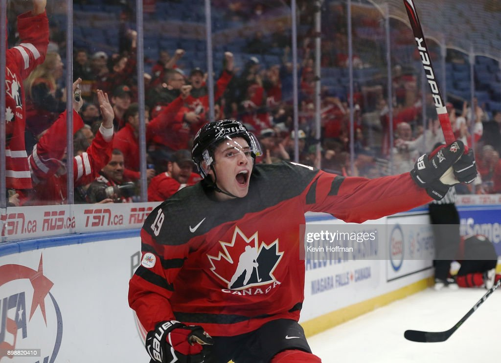 Drake Batherson #19 of Canada celebrates after scoring on Finland during the first period at KeyBank Center on December 26, 2017 in Buffalo, New York.