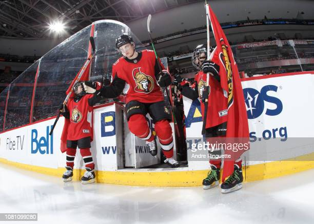 Drake Batherson of the Ottawa Senators steps onto the ice during player introductions prior to a game against the Boston Bruins at Canadian Tire...