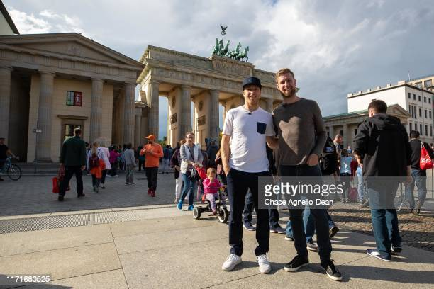 September 28 : Drake Caggiula and Calvin de Haan of the Chicago Blackhawks pose for a photo in front of the Brandenburg Gate September 28, 2019 in...