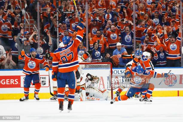 Drake Caggiula celebrates his goal with teammates Patrick Maroon Connor McDavid and Jordan Eberle of the Edmonton Oilers as goalie John Gibson of the...