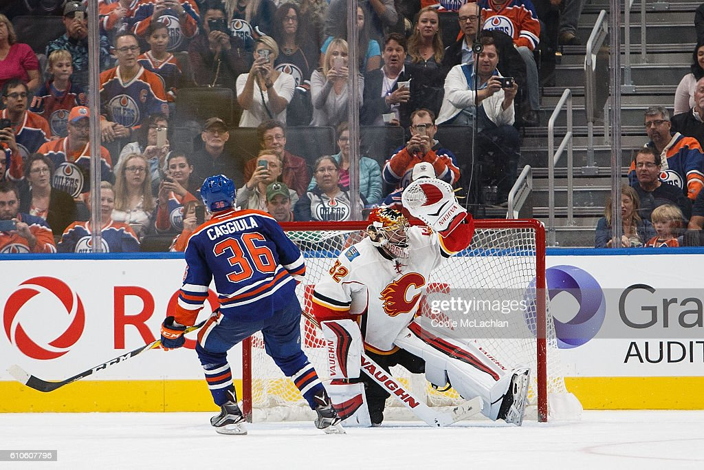 Drake Caggiula #36 of the Edmonton Oilers can't put a penalty shot past goaltender Jon Gillies #32 of the Calgary Flames in an NHL preseason game on September 26, 2016 at Rogers Place in Edmonton, Alberta, Canada.