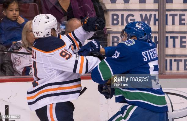 Drake Caggiula of the Edmonton Oilers collides with Troy Stecher of the Vancouver Canucks in NHL action on October 2017 at Rogers Arena in Vancouver...