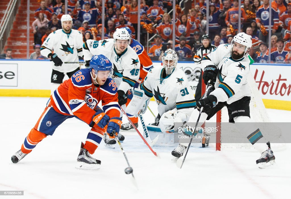 Drake Caggiula #36 of the Edmonton Oilers is defended by David Schlemko #5 of the San Jose Sharks in Game Five of the Western Conference First Round during the 2017 NHL Stanley Cup Playoffs at Rogers Place on April 20, 2017 in Edmonton, Alberta, Canada.