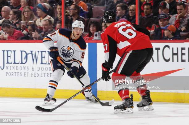 Drake Caggiula of the Edmonton Oilers skates with the puck against Ben Harpur of the Ottawa Senators in the first period at Canadian Tire Centre on...