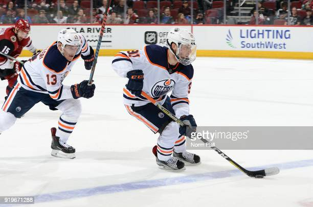 Drake Caggiula of the Edmonton Oilers skates with the puck ahead of teammate Michael Cammalleri during the third period against the Arizona Coyotes...
