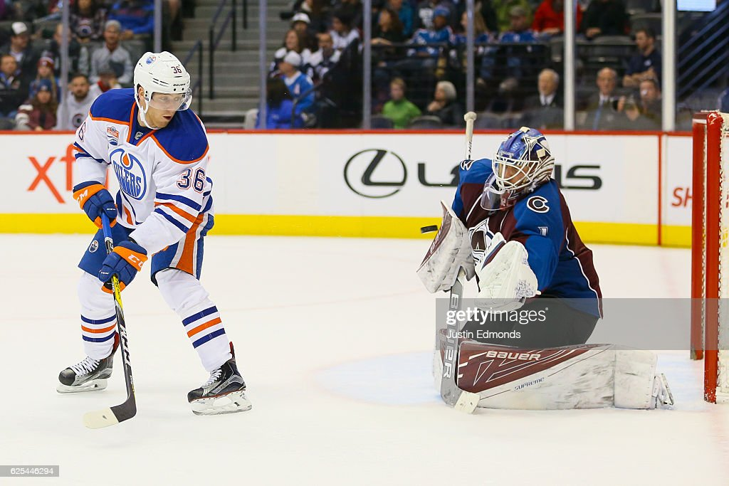 Drake Caggiula #36 of the Edmonton Oilers tips the puck but it is saved by Semyon Varlamov #1 of the Colorado Avalanche during the third period at Pepsi Center on November 23, 2016 in Denver, Colorado. The Oilers defeated the Avalanche 6-3.