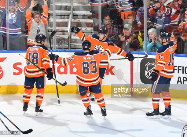 Drake Caggiula Ryan Strome Matthew Benning and Patrick Maroon of the Edmonton Oilers celebrate after scoring a goal during the game against the...