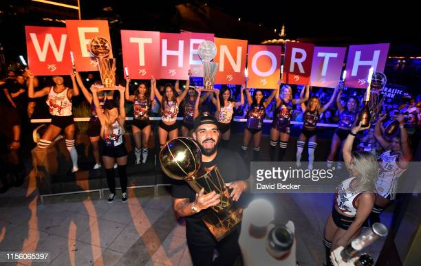 Drake carries the Larry O'Brien NBA Championship Trophy as he celebrates the Toronto Raptor's NBA championship at XS Nightclub at Wynn Las Vegas on...