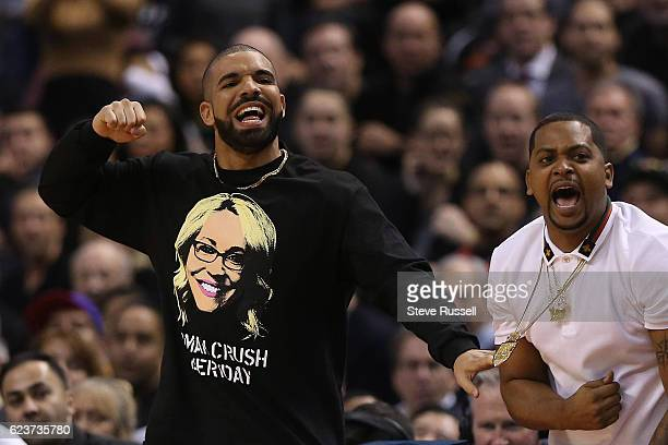 TORONTO ON NOVEMBER 16 Drake celebrates as the Raptors go on a run as the Toronto Raptors lose to the Golden State Warriors at the Air Canada Centre...