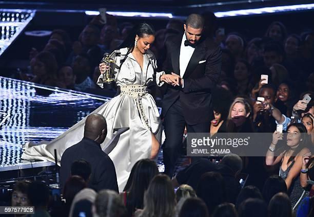 Drake escorts Rihanna after presenting her with The Video Vanguard Award during the 2016 MTV Video Music Awards at the Madison Square Garden in New...