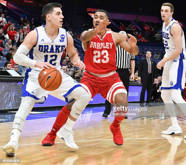 Drake guard reed Timmer drives the baseline around Bradley guard Dwayne LautierOgunleye during a Missouri Valley Conference Basketball Tournament...