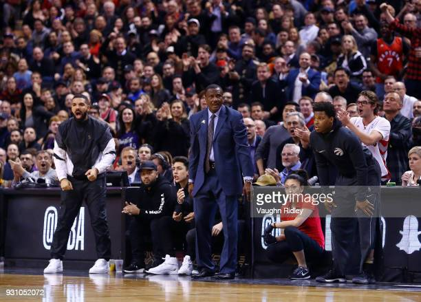 Drake Head Coach Dwane Casey and Kyle Lowry of the Toronto Raptors watch from the sidelines during the second half of an NBA game against the Houston...