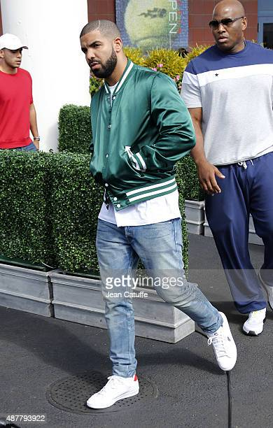 Drake leaves Arthur Ashe Stadium after attending Serena Williams' semifinal against Roberta Vinci of Italy on day twelve of the 2015 US Open at USTA...