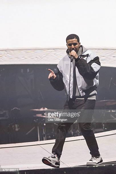 Drake performs onstage during a date of his 'Nothing Was the Same' 2014 World Tour at Nottingham Capital FM Arena on March 16 2014 in Nottingham...