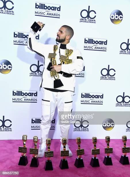Drake poses with awards at the 2017 Billboard Music Awards at TMobile Arena on May 21 2017 in Las Vegas Nevada