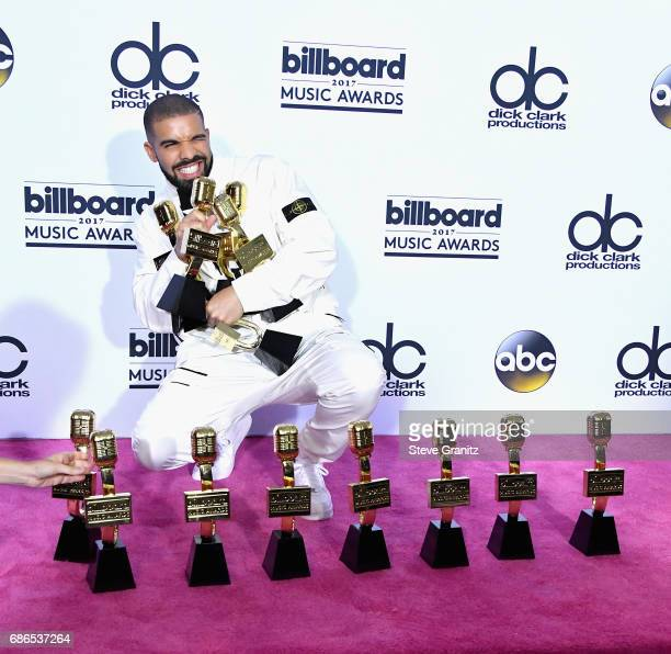 Drake poses with awards at the 2017 Billboard Music Awards at TMobile Arena on May 21 2017 in Las Vegas Nevada
