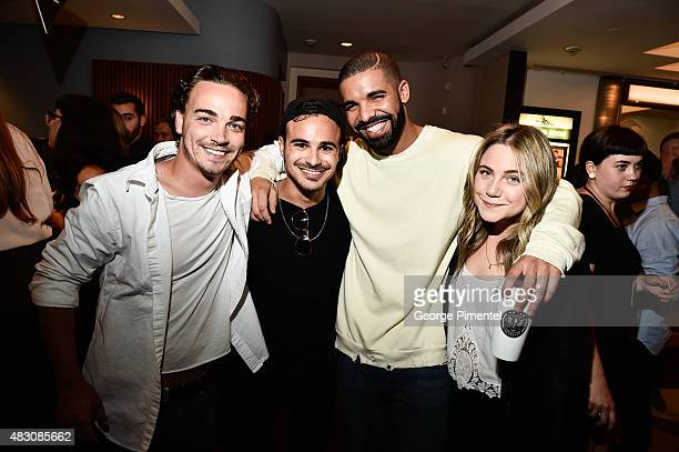 Drake poses with Degrassi costars Daniel Clark Adamo Ruggiero and Lauren Collins at the screening of We Are Disorderly held at the Royal Cinema on...
