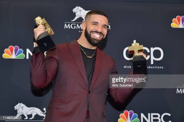 "Drake poses with the awards for Top Artist Top Male Artist Top Billboard 200 Album for ""Scorpion"" in the press room during the 2019 Billboard Music..."