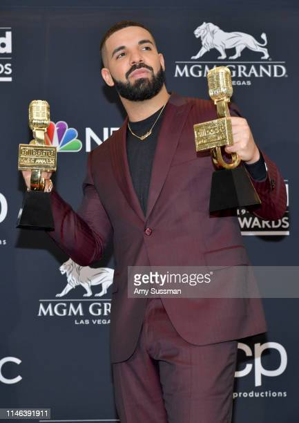 """Drake poses with the awards for Top Artist, Top Male Artist, Top Billboard 200 Album for """"Scorpion"""", Top Billboard 200 Artist, Top Hot 100 Artist,..."""