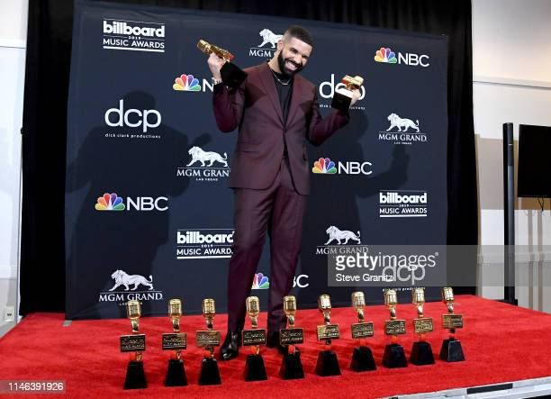 """Drake poses with the awards for Top Artist Top Male Artist Top Billboard 200 Album for """"Scorpion"""" Top Billboard 200 Artist Top Hot 100 Artist Top..."""