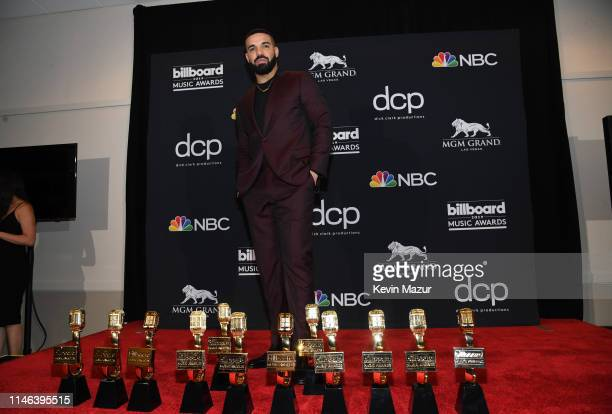 "Drake poses with the awards for Top Artist Top Male Artist Top Billboard 200 Album for ""Scorpion"" Top Billboard 200 Artist Top Hot 100 Artist Top..."
